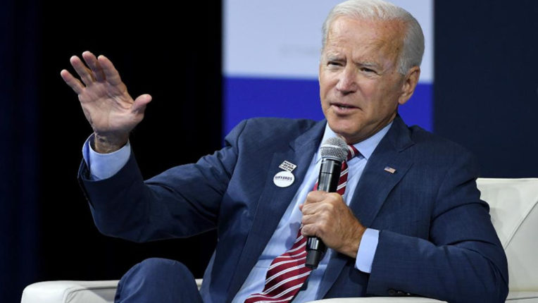 Before the oath ceremony, Biden's said, America is coming back to its old color