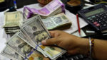 Rupee rises 14 paise to Rs 74.52 in early trade against US dollar