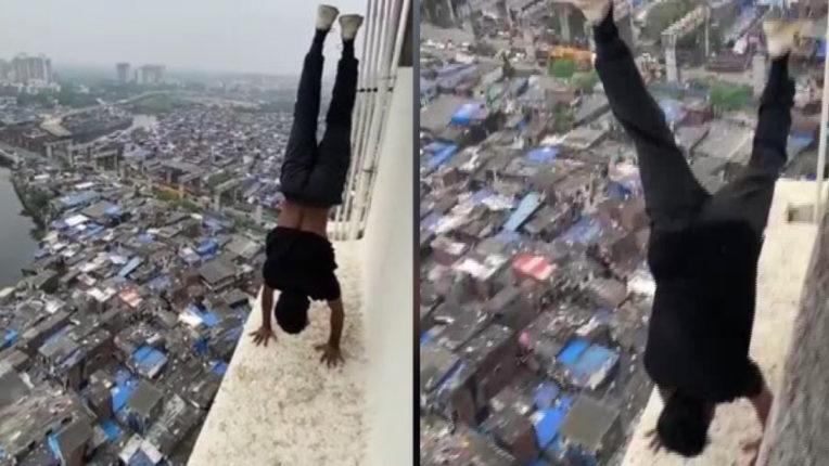 Man arrested for doing dangerous 'handstand stunt' on 22nd floor of the building parapet