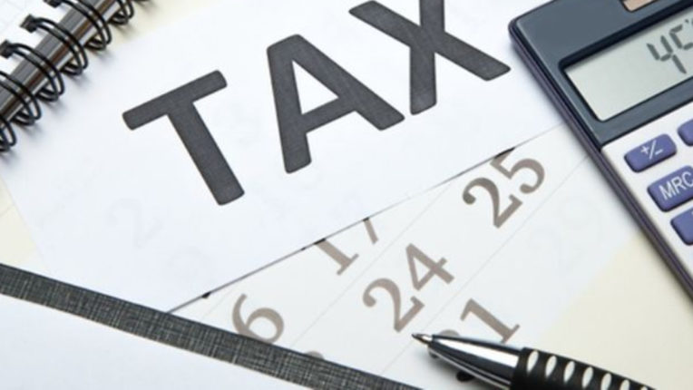 Indian-origin shopkeeper banned for tax crime