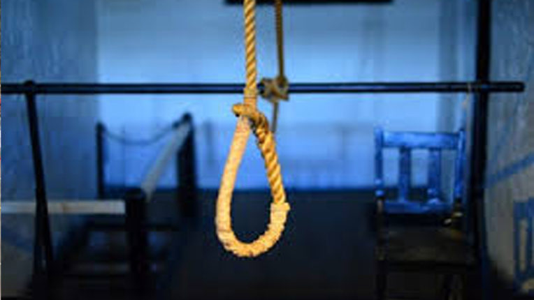 A person commits suicide by hanging