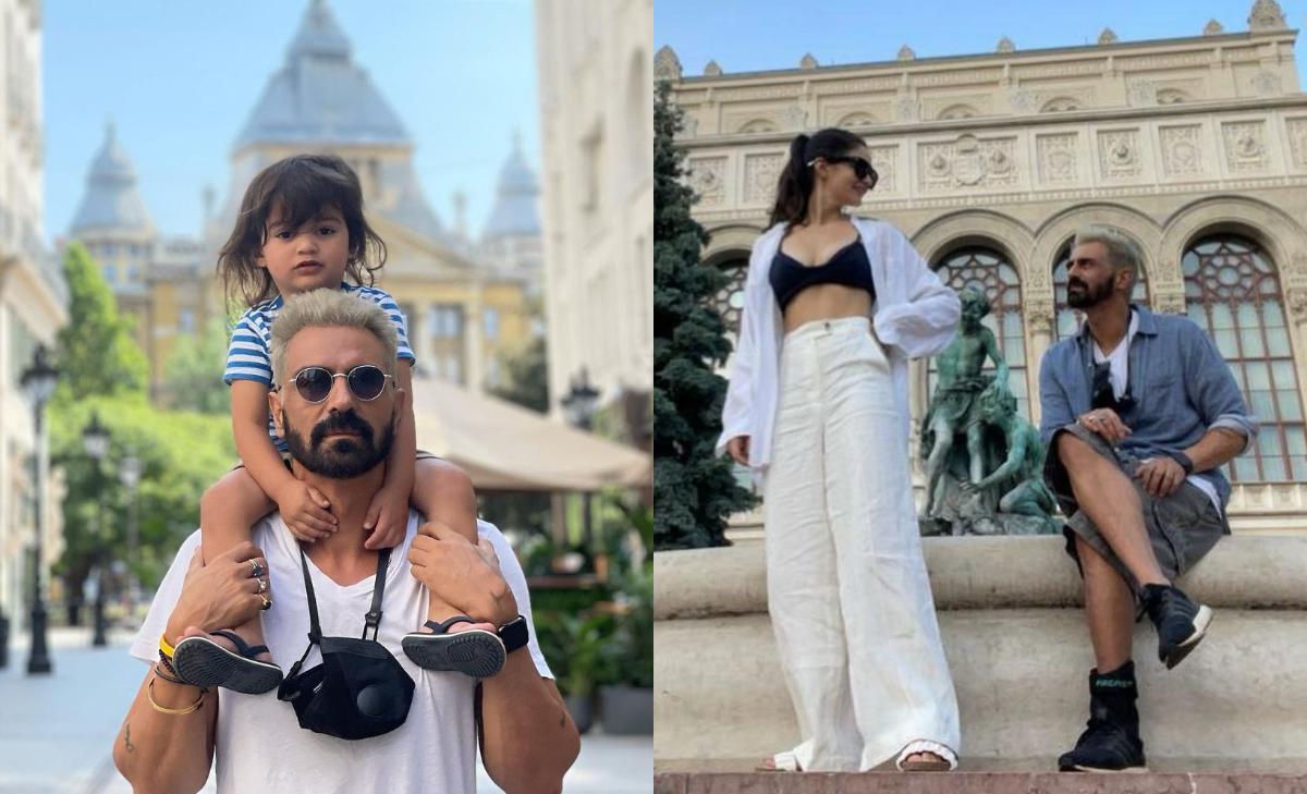 Arjun Rampal having fun with his family while shooting for 'Dhaakad' in Budapestum, see photos: बॉलीवुड अभिनेता अर्जुन रामपाल (Arjun Rampal) बहुत जल्द अभिनेत्री कंगना रनौत के साथ अपकमिंग फिल्मल 'धाकड़' में स्क्रीन शेयर करते दिखाई देंगे। इन दिनों 'धाकड़' की पूरी टीम बुडापेस्ट में शूटिंग के लिए पहुंची है। अभिनेता अर्जुन भी अपने परिवार के साथ बुडापेस्ट पहुंचे थे। काम के साथ-साथ अर्जुन अपने परिवार के साथ मस्ती के पल बिताते दिखाई दिए। बुडापेस्ट में इस समय अभिनेता अर्जुन के साथ लिव-इन पार्टनर गैब्रिएला डिमिट्रिनयाडेस (Gabriella Demetriades) और बेटे अरिक (Arik) भी मौजूद हैं। मालूम हो कि फिल्म 'धाकड़ के लिए अभिनेता ने अपने पूरा लुक बदल दिया है वह इस फिल्म के लिए बालों को प्लैीटिनम ब्लॉेन्ड  कलर किया है। देखें तस्वीरें- (फोटो साभार- @ Arjun Rampal)