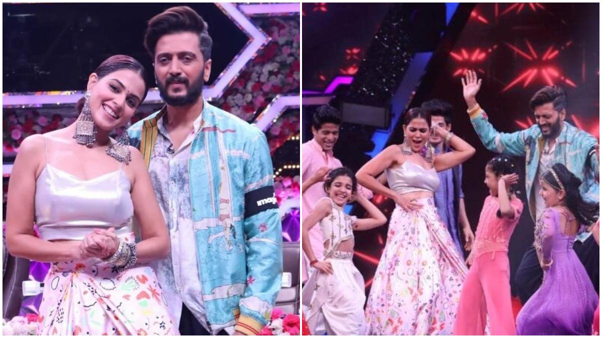 Riteish Deshmukh and Genelia D'Souza 'replace' Shilpa Shetty, will be seen rocking the wedding special episode: डांस रियलिटी शो 'सुपर डांसर चैप्टर 4' (Super Dancer Chapter 4) में इस बार शिल्पा शेट्टी की जगह बॉलीवुड की की पसंदीदा जोड़ी जेनेलिया डिसूजा (Genelia Dsouza) और रितेश देशमुख (Ritesh Deshmukh) मेहमान बन कर पहुंचेंगे। रितेश और जेनेलिया ने 'सुपर डांसर चैप्टर 4' का शादी स्पेशल एपिसोड शूट कर लिया है। शूटिंग के दौरान ली गई कुछ तस्वीरें सामने आई हैं। जिसमें बॉलीवुड का ये कपल कंटेस्टेंट्स के साथ धूम मचाते नजर आ रहे है। रितेश और जेनेलिया ने 'सुपर डांसर चैप्टर 4' के मंच पर डांस के अलावा अपने से जुड़े राज का भी खुलासा किया। इस हफ्ते भी शो में शिल्पा शेट्टी नजर नहीं आने वाली हैं। जिस कारण शिल्पा की जगह पिछले एपिसोड में अभिनेत्री करिश्मा कपूर आई थी और इस बाद रितेश और जेनेलिया दर्शकों का 'सुपर डांसर चैप्टर 4' शो का हिस्सा बनते हुए डांसर कंटेस्टेंट्स को जज करते दिखाई देंगे। आप भी नजर डाले इन तस्वीरों पर- (फोटो साभार- @ Super Dancer Chapter 4)